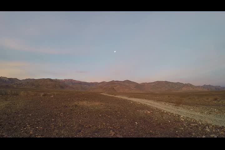 1053 Windy sunrise panorama video from Hanaupah Canyon Road