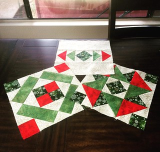 Finished fixing the messed up corner block for the #dbqchristmasbom. Now to finish the top! Loving this #rainydaysewing. #blockofthemonth