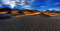 Golden Dunes and Clouds