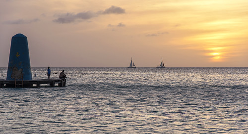 sunset sun dusk aruba onehappyisland island beach boat water sea caribbean dadson outdoor landscape yellow clouds sky relax holiday