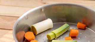 Carrot and leek on pressure cooker wire basket | by annick vanderschelden