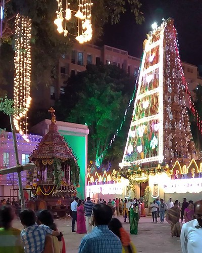 When ths usually quiet temple behind our place decides to put its festival lights on and procession cart out, people are coming from everywhere and queue silently. Always surprised how festivals can happen anywhere at anytime and get crowds visiting. #tem | by Scalino