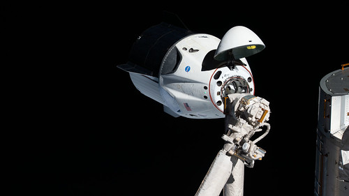 The uncrewed SpaceX Crew Dragon spacecraft on approach to the station's Harmony module