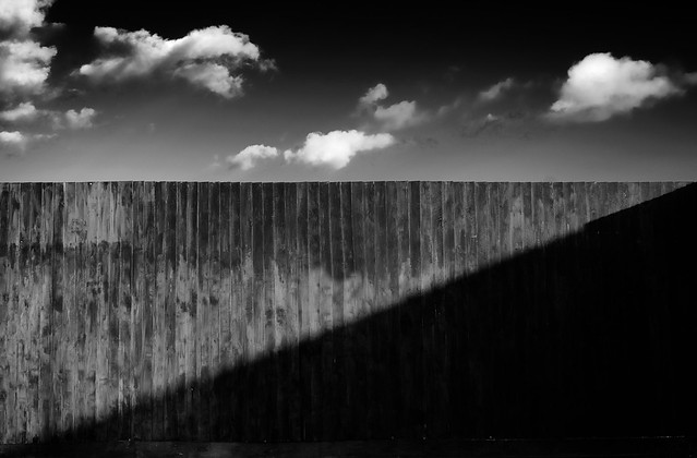 Fence, cloud and shadow