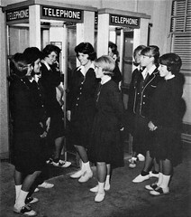 Students in 1963 at the telephone booths, at Immaculate Heart High School in Los Angeles, CA