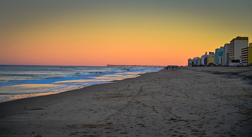 virginiabeach virginia unitedstates us the beach sunset over atlantic ocean va usa america evening dusk water shore shoreline coast coastline surf yellow orange pink