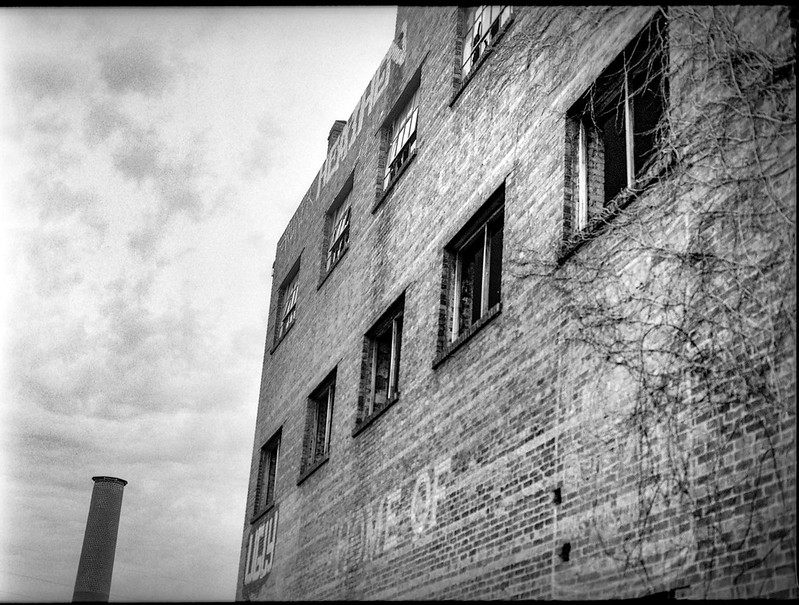 brick facade, abandoned warehouse, smokestack, River District, Asheville, NC, Mamiya 645 Pro, mamiya sekor 80mm f-2.8, Kodak Tri-X 400, HC-110 developer, 4.9.19