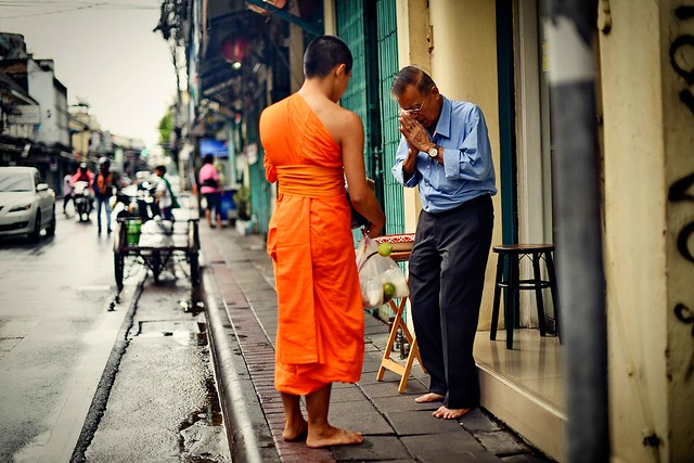 A young monk and an almsgiver