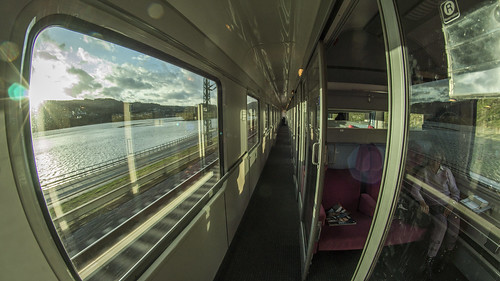 train coach carriage compartment db germany avmz wegmann corridor window river rhine sunset clouds interior