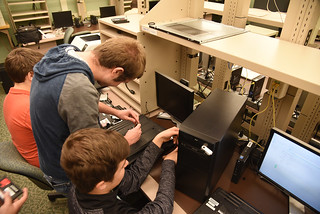 Thu, 10/25/2018 - 13:52 - A photograph of GCC's Computer Repair Club working on the laptops, courtesy of GCC