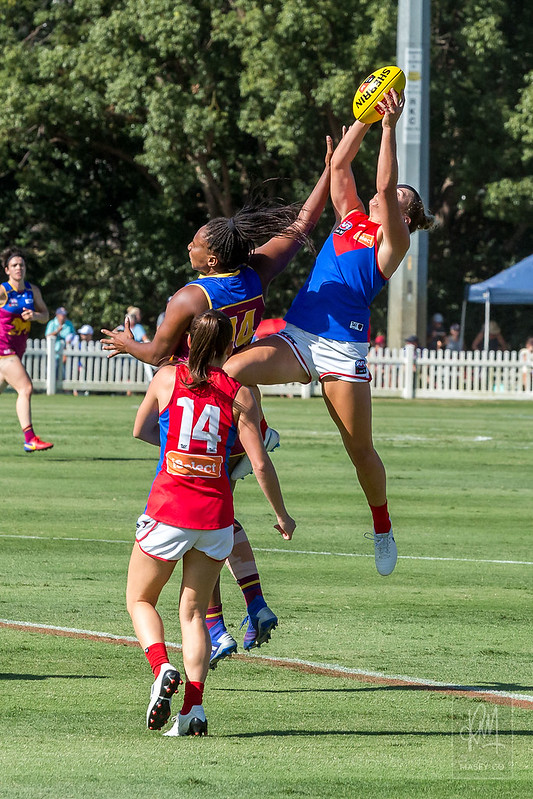 Sabrina Frederick-Traub assists a Demon flyer