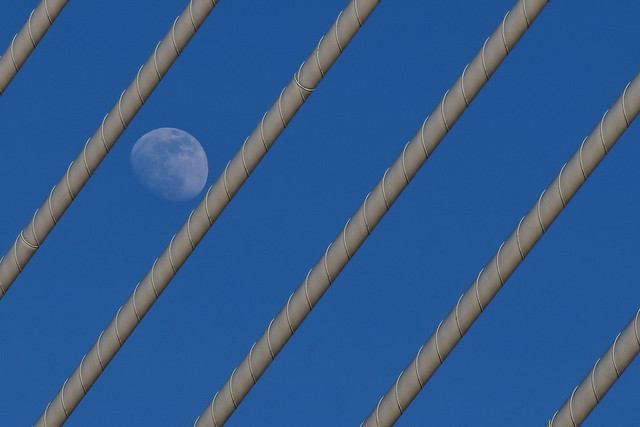 Moonshine on a clear daytime sky