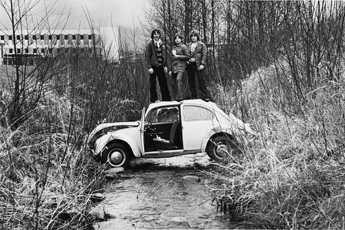 Classic photograph of Guichon Creek with students standing on a discarded car.