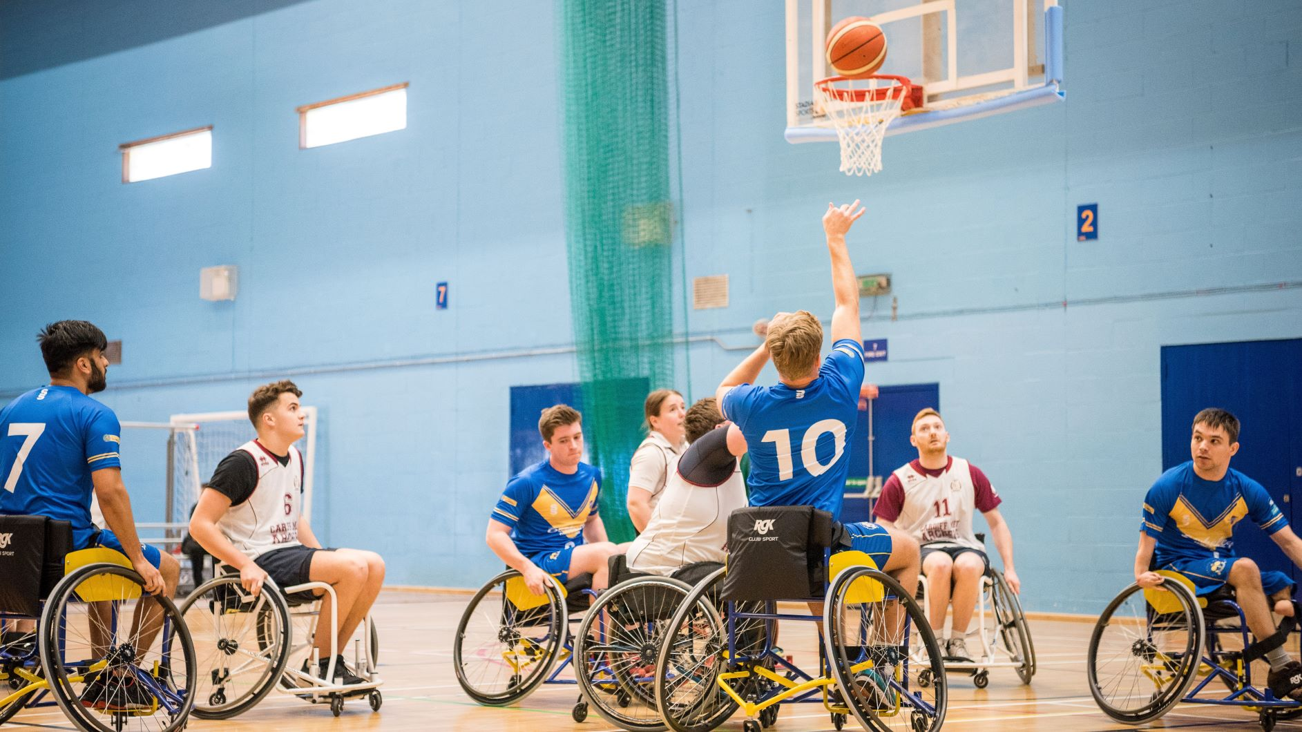 Wheelchair basketball teams playing