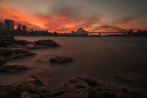 sydneyoperahouse harborbridge sydney newsouthwales australia nsw harbor ocean bay water sunset evening sky clouds rocks longexposure le cityscape landscape