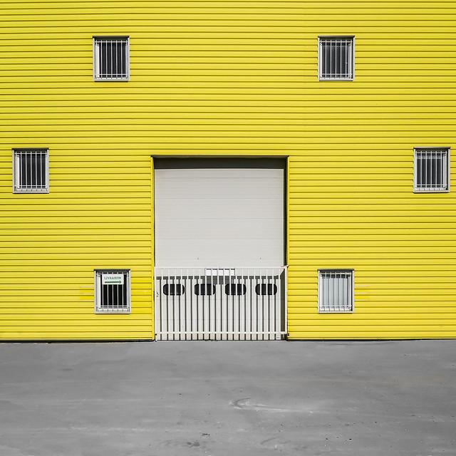 Windows on yellow wall