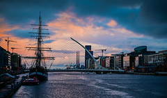 River Liffey with Jeanie Johnston Tall Ship and Samuel Beckett Bridge at Dusk - Dublin Ireland