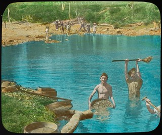 Boys panning for gold in a creek, Queensland, ca. 1910
