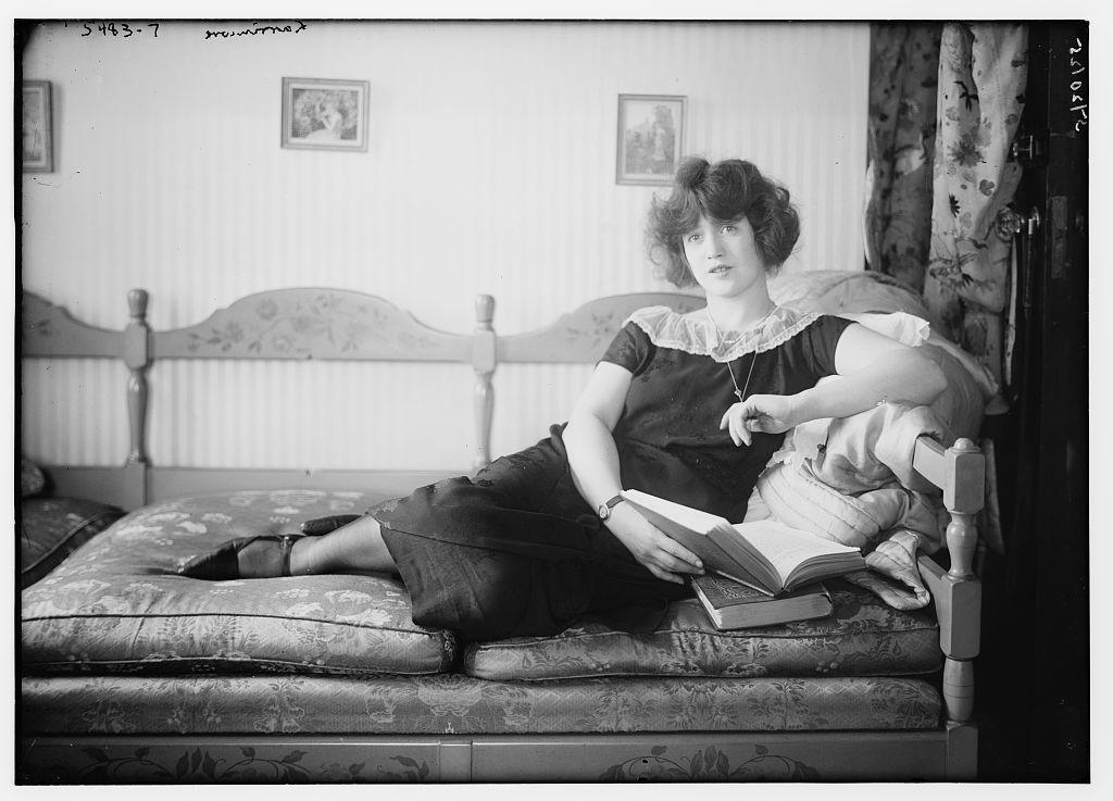 Larrimore [lying on sofa, book in hand] (LOC)