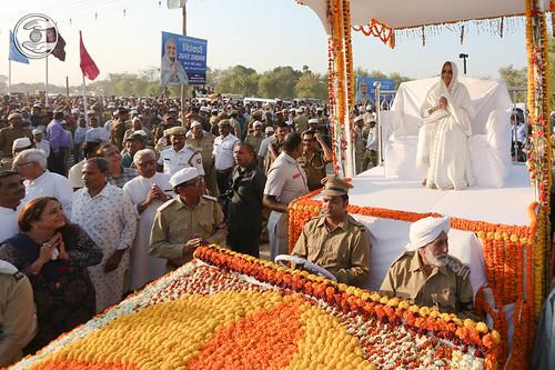 Satguru Mataji on flower bedecked open carriage