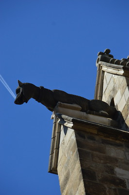 Gargoyle with perfectly timed and placed aircraft vapour trails