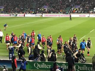 The England team warming up at Twickenham Stadium