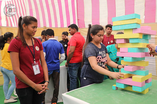 Devotees playing game Jenga