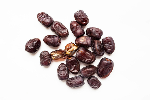 Top view of fresh iranian dates on white background