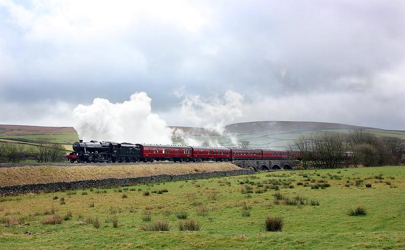 8F No.48151 works steadily away past Helwith Bridge with 'The Settle & Carlisle Thunderer I'.