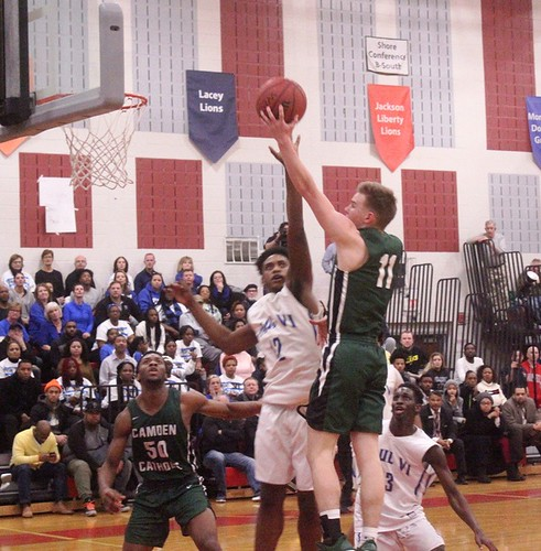 Camden Catholic's Pat Corbett goes hard to the hole for layup with his off hand. | by tedtee308