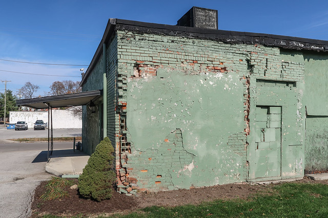A longtime rustic wall continues to hold itself together even yet. A restaurant is inside.