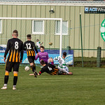 Steven Ross (20) slides in to level for Buckie
