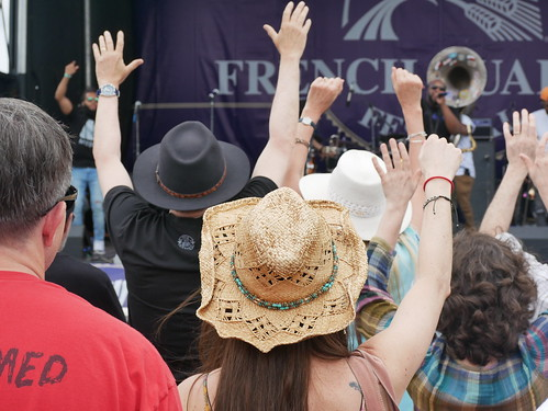 Audience loving The Soul Rebels on Day 2 of French Quarter Fest - 4.12.19. Photo by Louis Crispino.