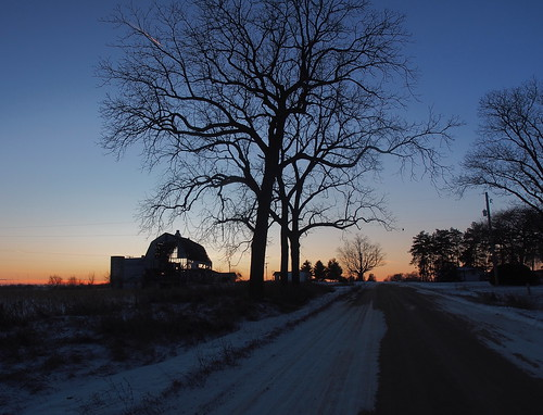 sunset silhouette barn partial color