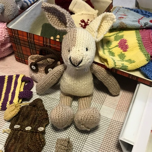 Aileen's finished Bunny that she knit for our Bunny class surrounded by the wardrobe Kathy knit for hers!