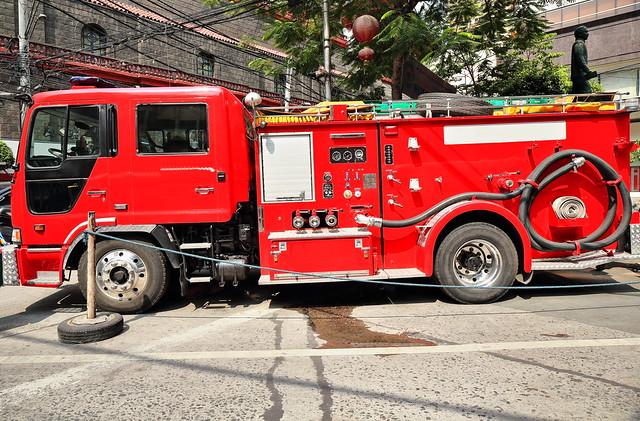 Red fire engine on duty ready to work. Binondo District-Chinatown-Manila-Philippines-0993