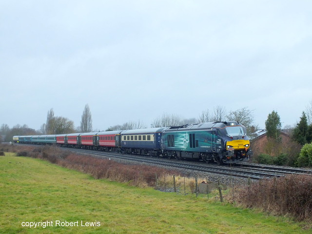 68005 passing Redhill,Hereford on the 13-02-2015 with the 1Z68 Carmarthen to Edinburgh Pathfinder tours six nations welsh rugby supporters train.