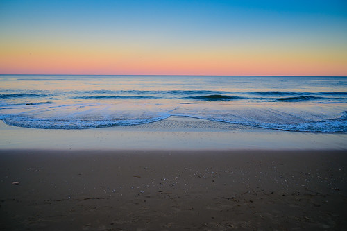 virginiabeach virginia unitedstates us the beach sunset over atlantic ocean va usa america evening dusk water shore shoreline coast coastline surf yellow orange pink