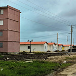 """Community of Nueva Isabela with it's old Russian inspired Gran Panel 4 buldings and the brand new """"Petro-Casas"""""""