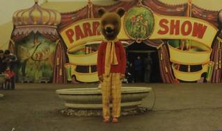 Rupert Bear outside the Parrot Show