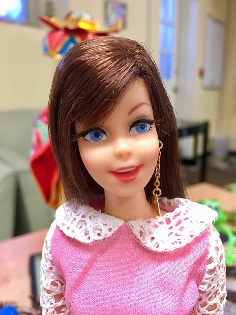 I love the longer length of her hair, as a variation.