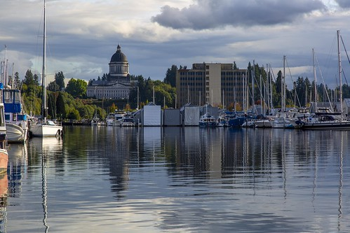 olympia pacificnorthwest urban landscape capitol building legislature dome masonry washington boat marina lake placid watersurface rippled cloudy clouds mast sail sailboat reflection