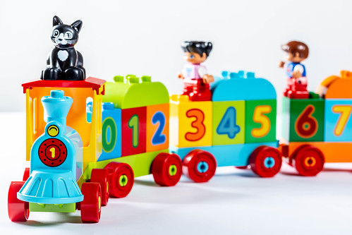 Toy train with wagons carries kids and cat | by wuestenigel