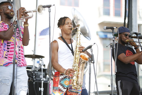 New Breed Brass Band on Day 1 of French Quarter Fest - 4.11.19. Photo by Michele Goldfarb.