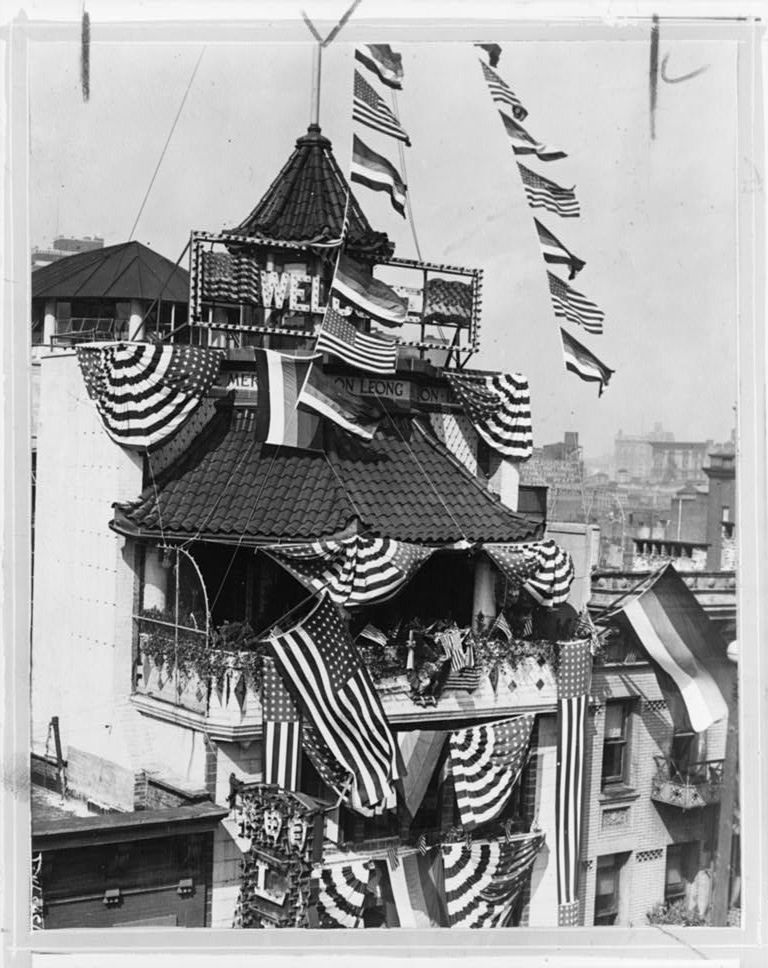 [Building in Chinatown, New York City, draped with flags for an eleven day celebration commemorating the founding of the new Chinese Merchants' Association] (LOC)
