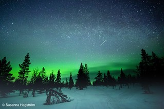 Milkyway and falling star in aurora borealis. | by Blackpeppereye