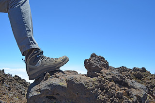 Boots on volcanic rock   by BuzzTrips