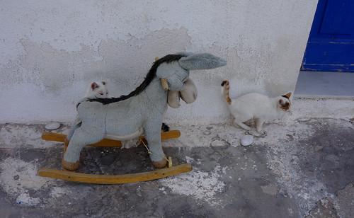 Rocking horse donkey and kitties, Apollonas, Naxos | by jmlwinder