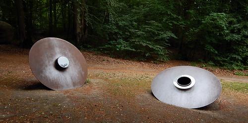 Two sculptures of metal circles at the Silkeborg Sculpture Garden in Denmark