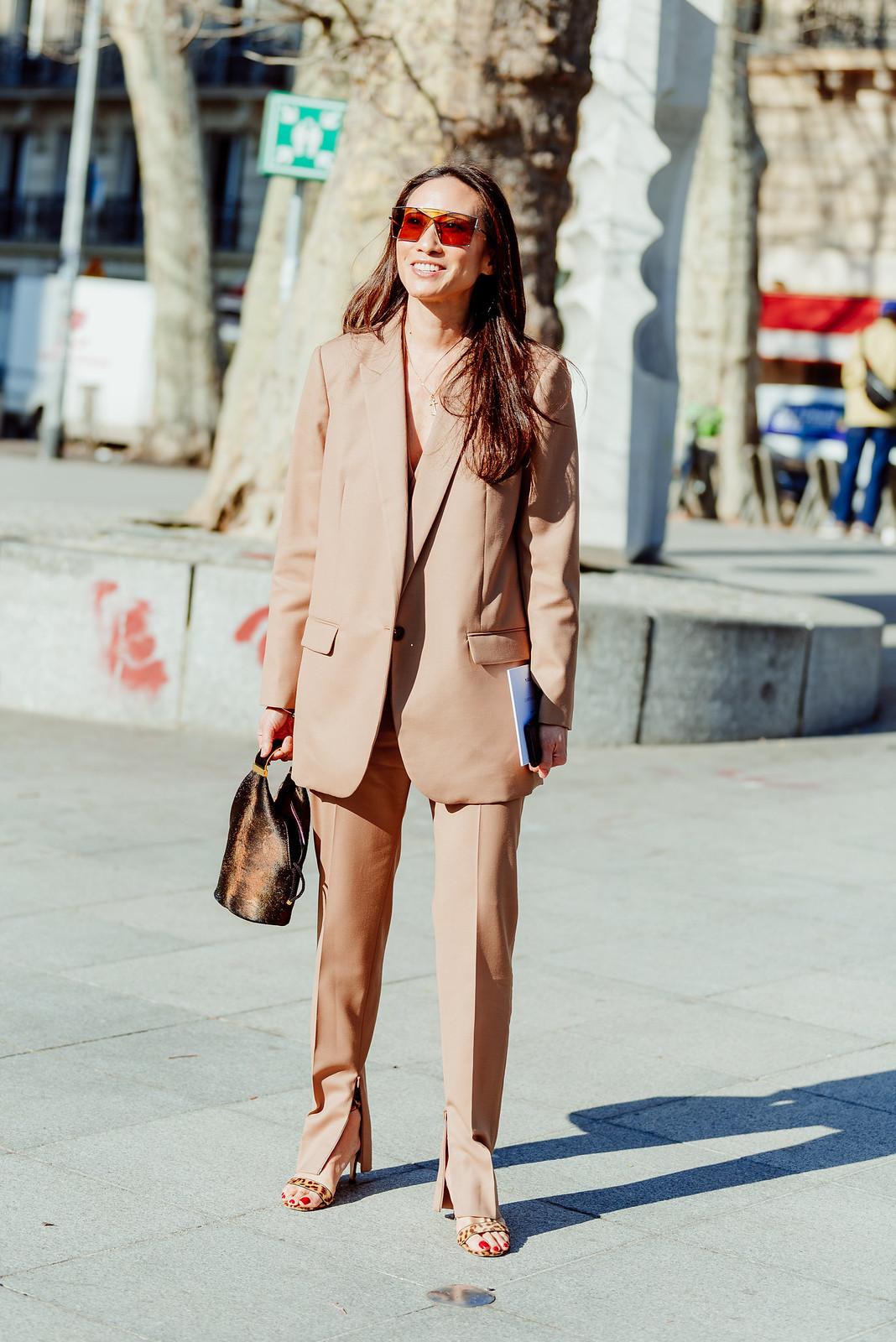 Woman in a beige suit.